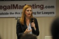 Mischelle Davis giving a presentation at a Great Legal Marketing Super Conference.